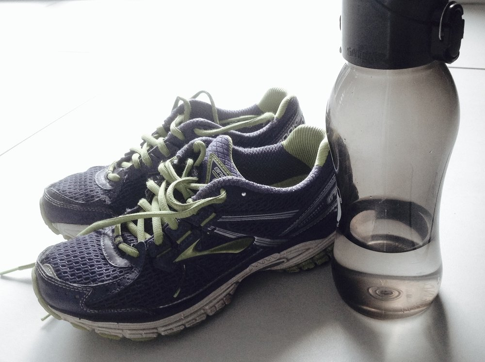 Runners can be greener by choosing reusable water bottles over disposable ones and recycling worn-out running shoes.