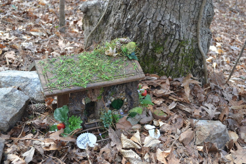 This little house for fairies, and nature's friends, placed at the foot of a tree along a walking trail in the forest was made with natural materials. The strawberry themed cottage is located at the Chattahoochee Nature Center in Roswell, Georgia.