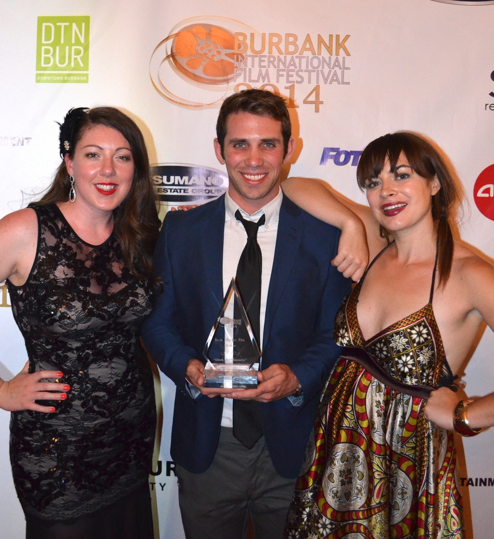 Megan Waters, Zach Silverman, Katy Foley with BIFF award for best horror feature film.