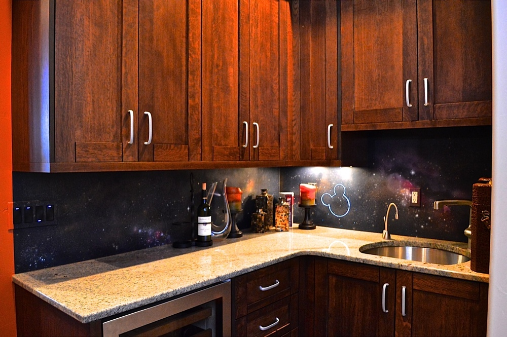 Milky way galaxy painted in backsplash to act as back drop for LED Mickey Mouse Constellation