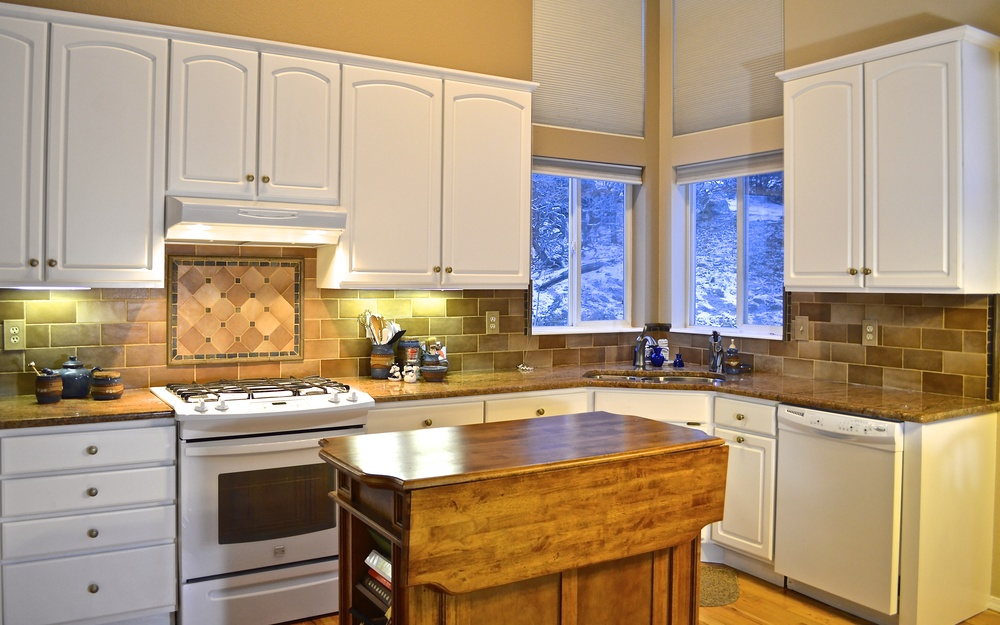 Granite Counter tops, custom tile, new sink, faucet, mobile kitchen island, and paint