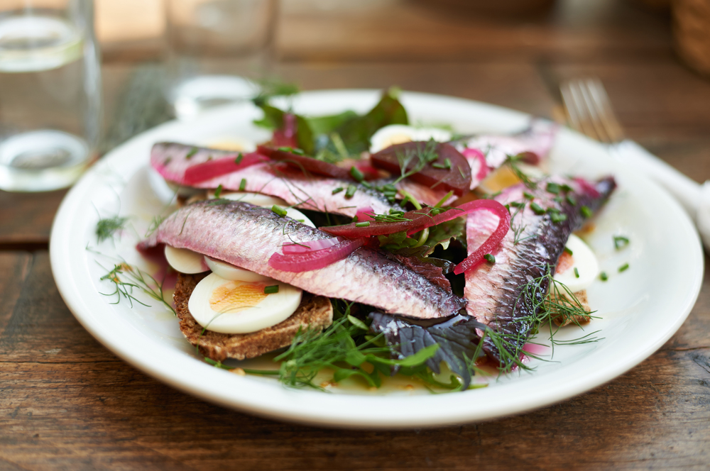 food photography of Swedish herrings on rye bread