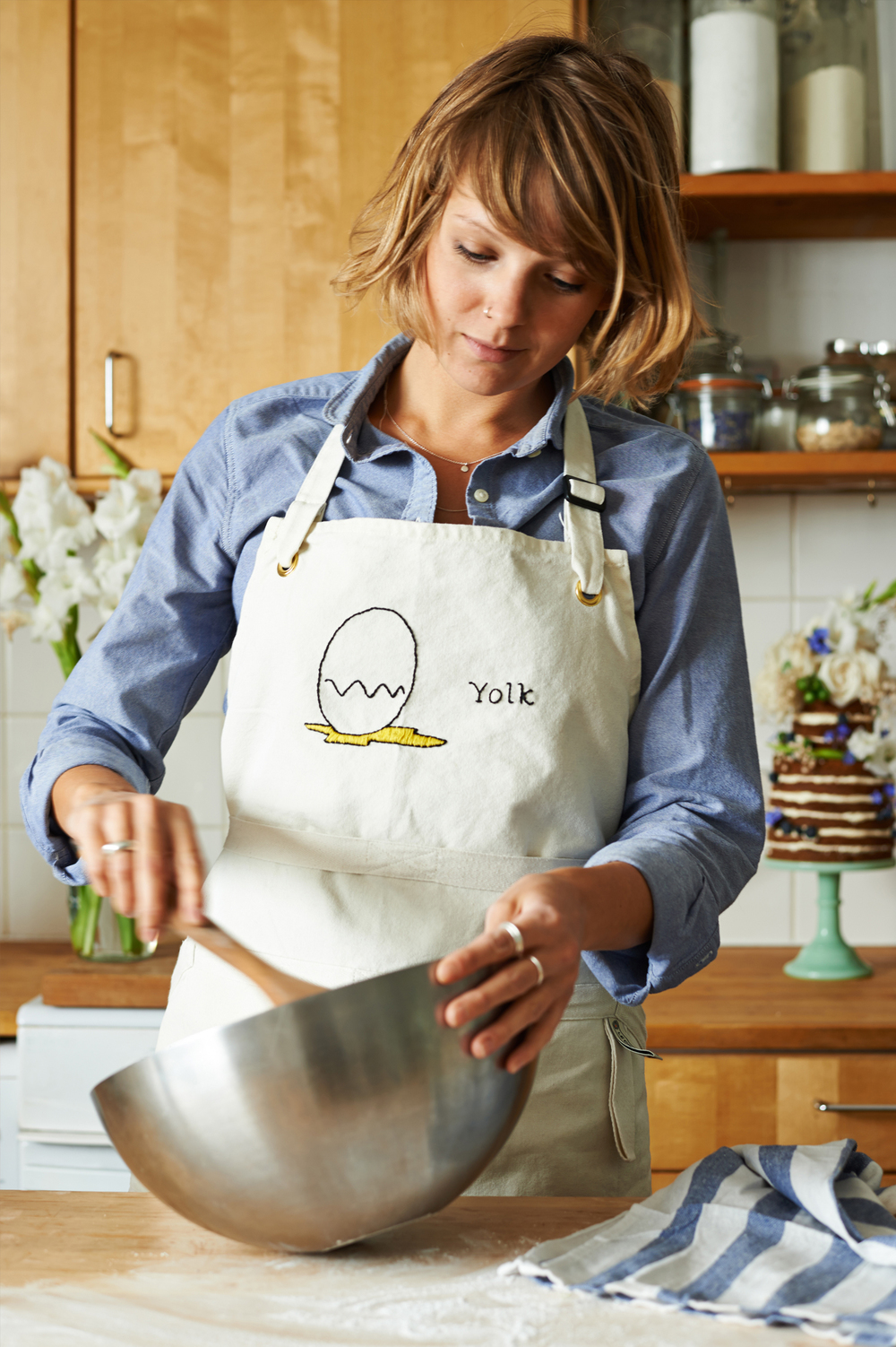 lifestyle photography of a woman baking cakes