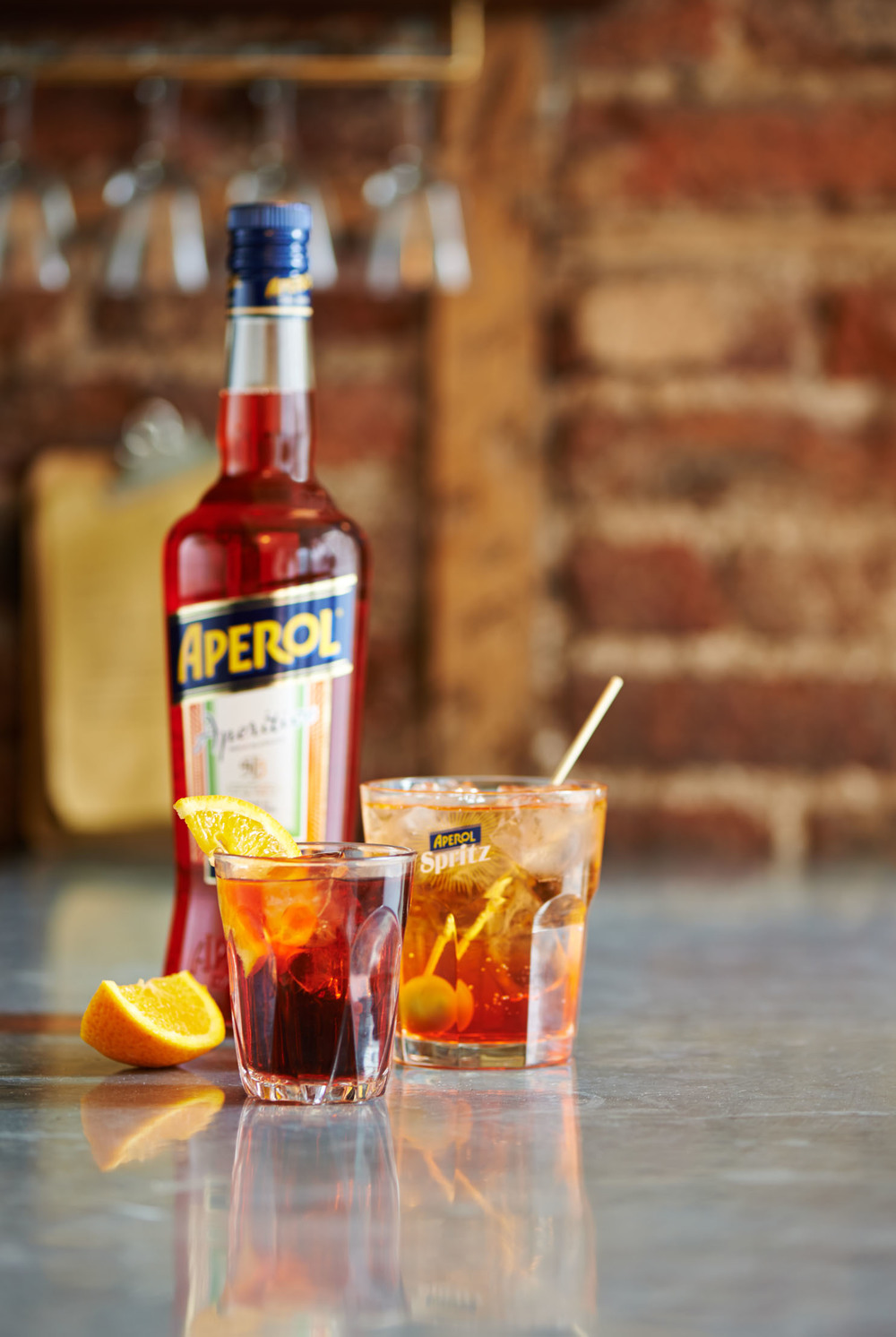 bottle of Aperol and glass of Aperol Spritz