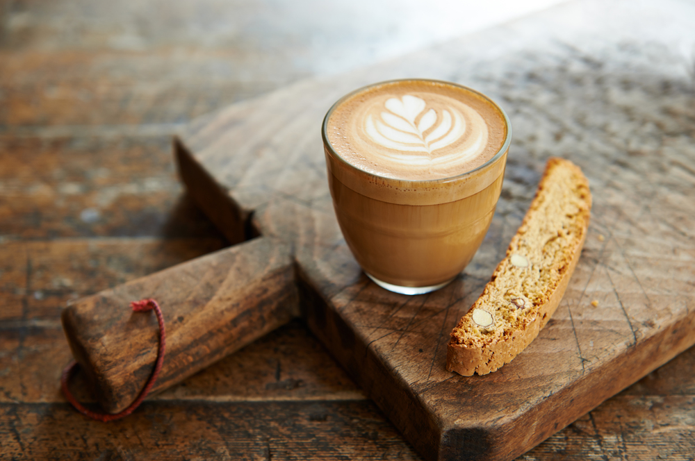 coffee and biscotti on a wooden board