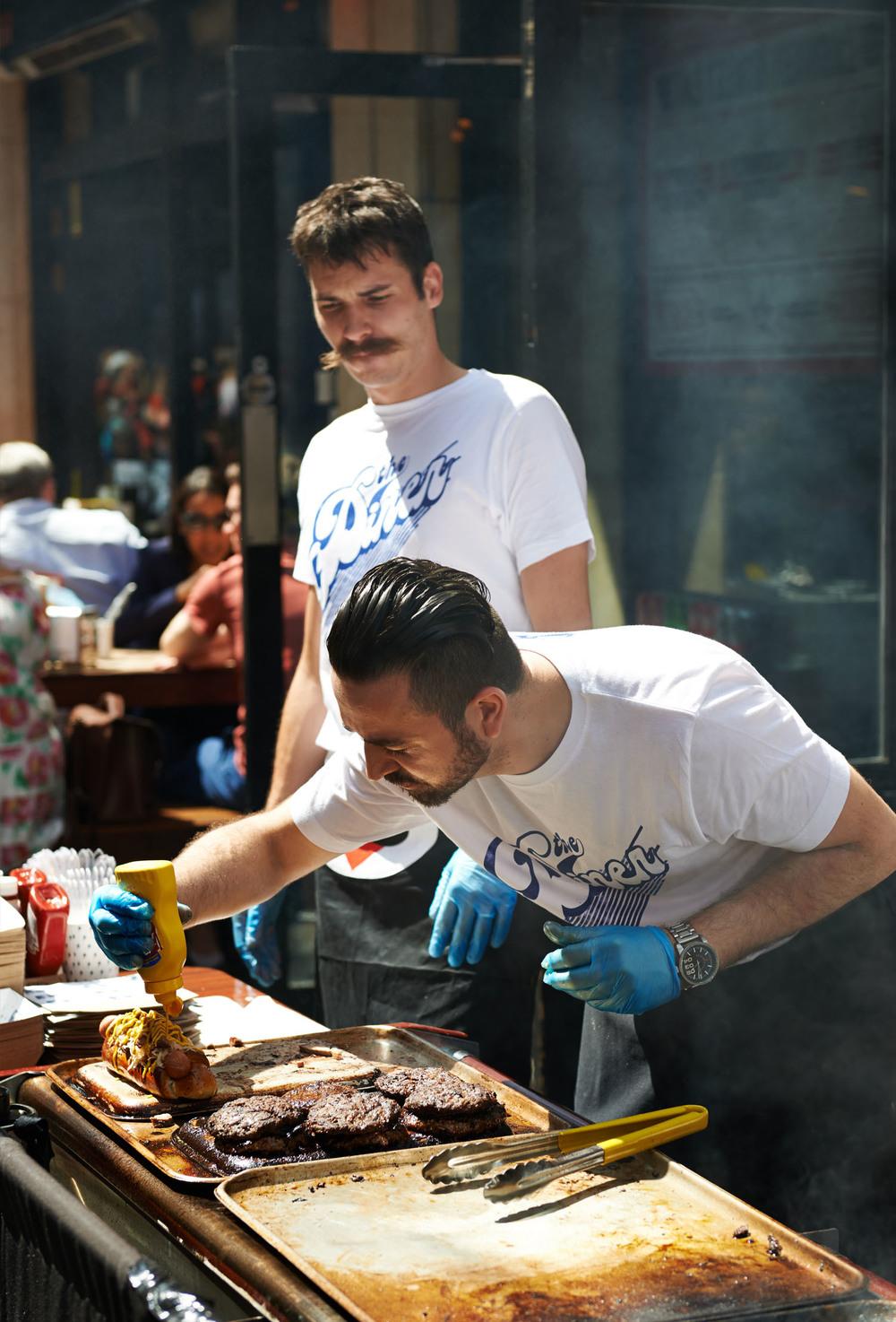 men cooking street food in Soho