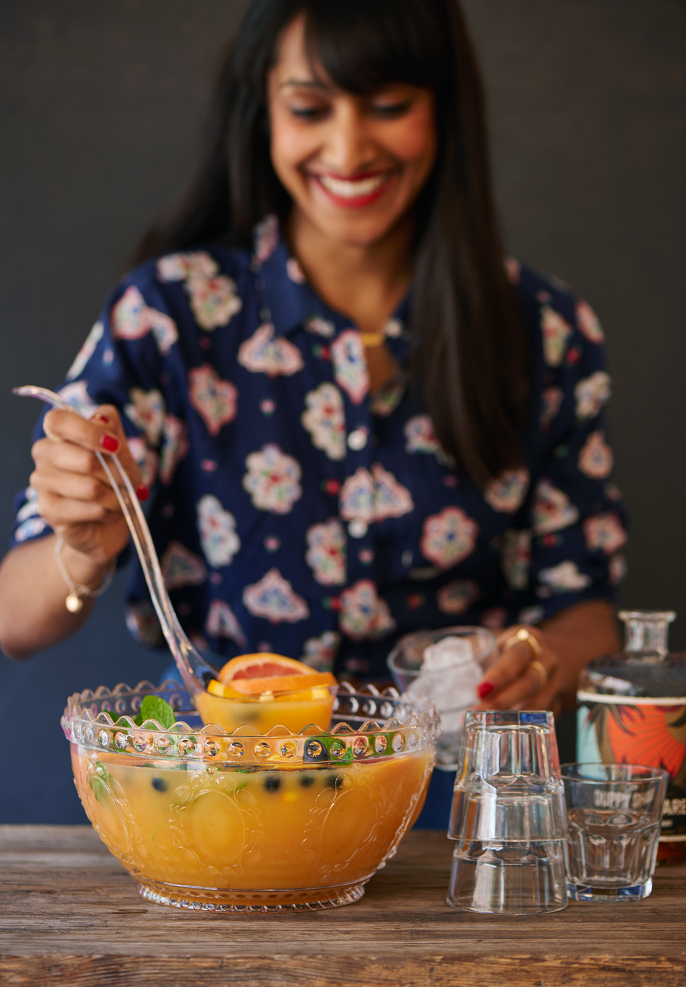 lifestyle image of woman serving rum punch