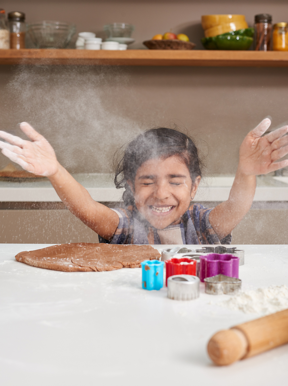 lifestyle photography of little girl baking