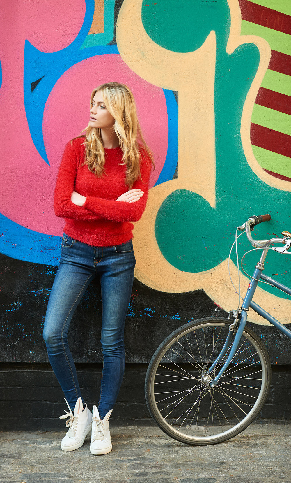 lifestyle photography  of a female model with a bicycle