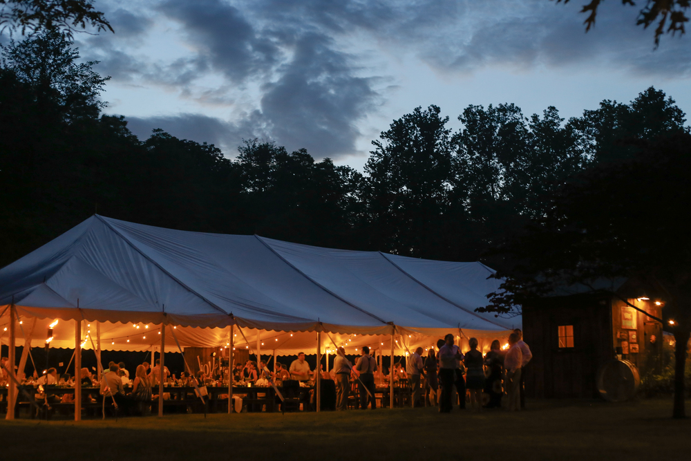 st louis backyard tent reception at dusk