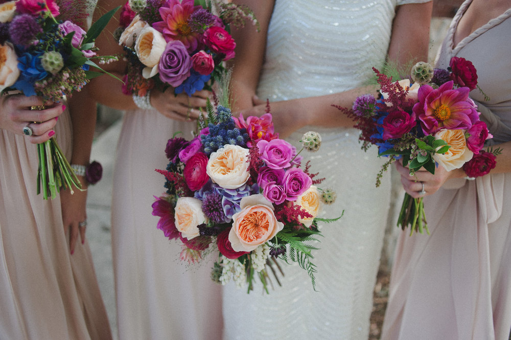 Adding a Juliet to a jewel tone wedding palette, can help break up and soften the colors. GORG!