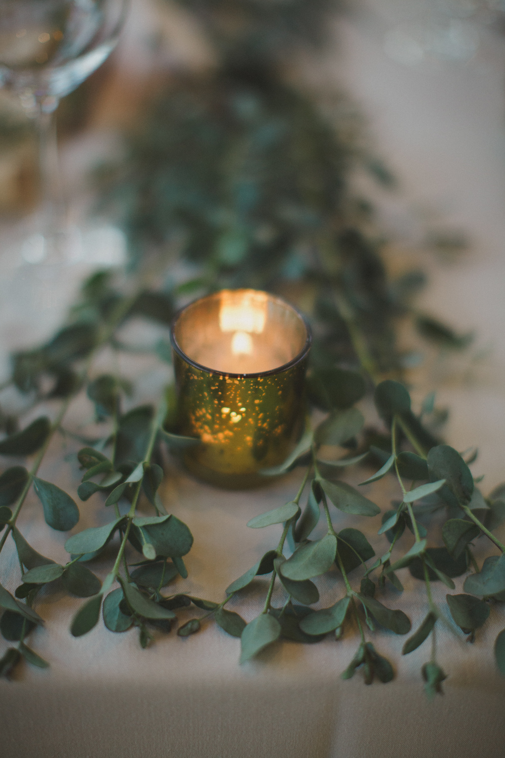Flowers by Lace and Lilies, gold votive with greenery garland, Vail Colorado