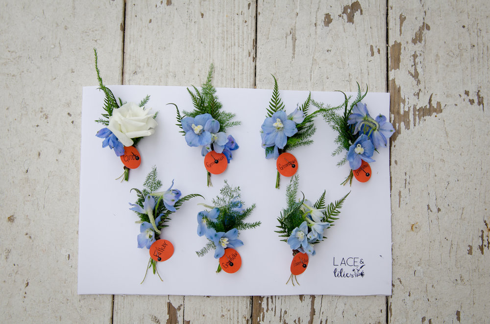 Flowers by Lace and Lilies, blue and white wedding boutonniere, delphinium, spray rose and fern