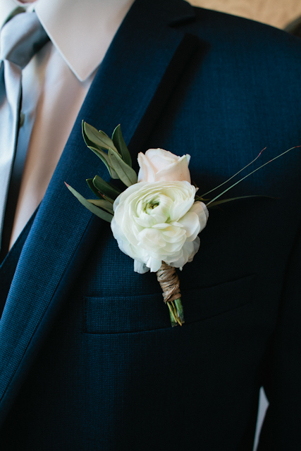 Flowers by Lace and Lilies, white ranunculus and blush spray rose boutonniere with eucalyptus