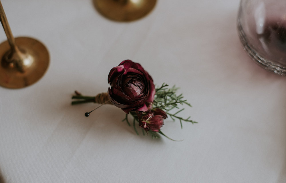 Flowers by Lace and Lilies, fall burgundy red boutonniere, winter greens and ranunculus, mountain wedding