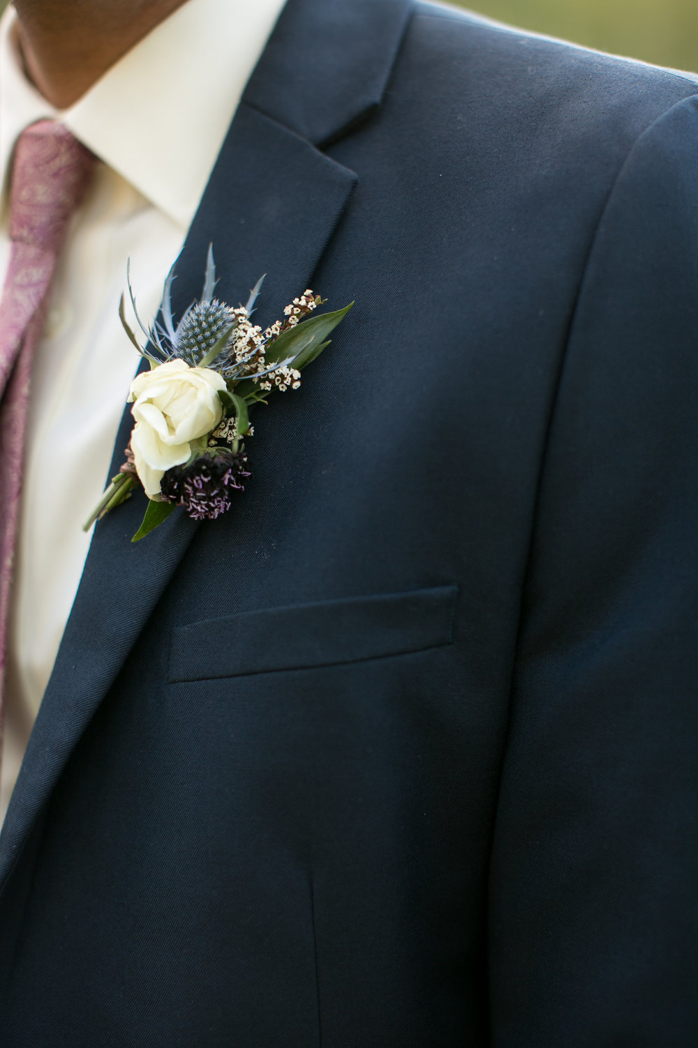 Flowers by Lace and Lilies, blue thistle and white spray rose boutonniere, groom in blue suit - mountain summer wedding