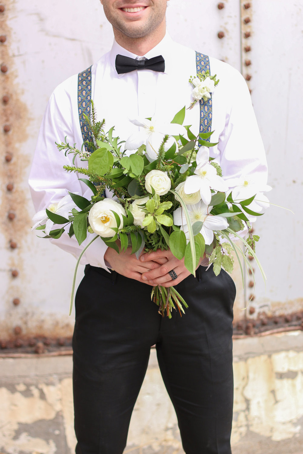 Flowers by Lace and Lilies, green foliage and white flower bouquet and boutonniere, suspenders and bow tie
