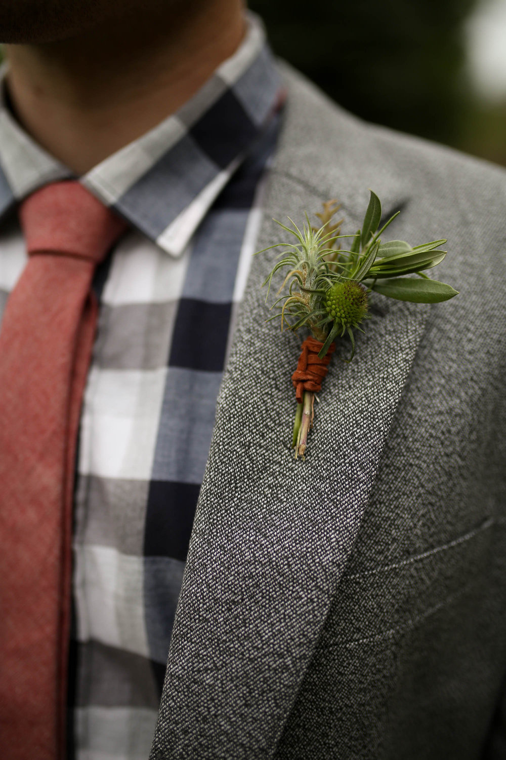 Flowers by Lace and Lilies, manly foliage boutonniere with leather wrap - airl plant, scabiosa and olive branch