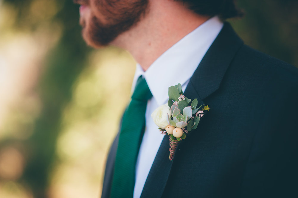 Flowers by Lace and Lilies, succulent, hypericum berry and ranunculus boutonniere, blue suit groom