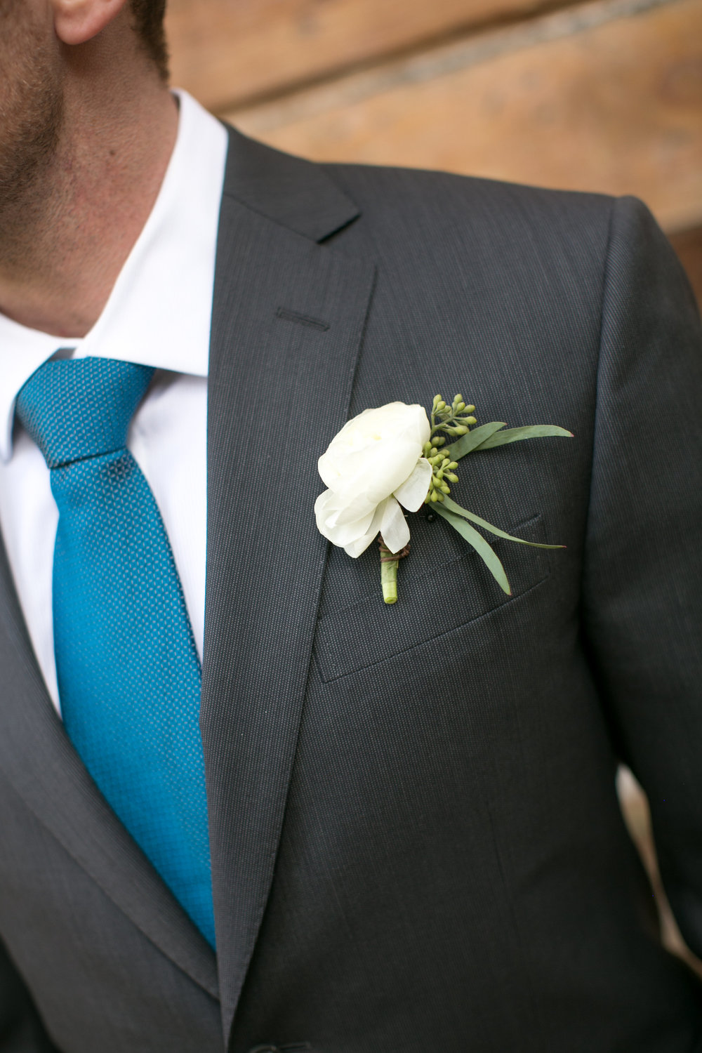 Flowers by Lace and Lilies, white ranunculus and seeded eucalyptus boutonniere, simple and classic