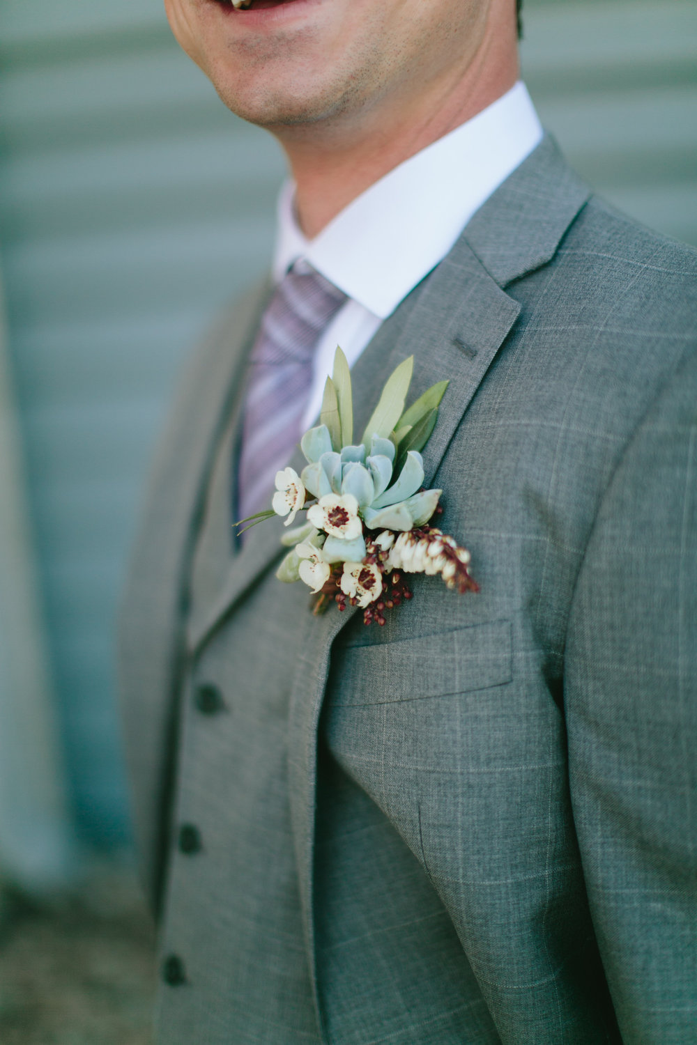 Flowers by Lace and Lilies, Succulent, Bay Leaf, Wax Flower and Pieris boutonniere, 3 piece gray suit groom