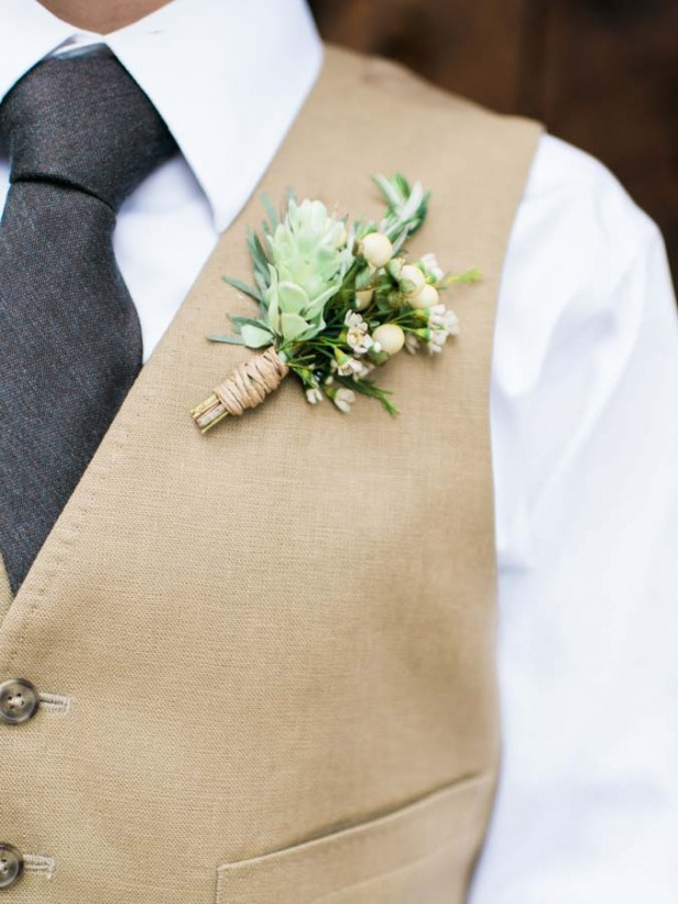 Flowers by Lace and Lilies, hops and olive branch boutonniere, twine wrap. vest and tie groom