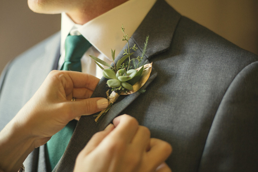 Flowers by Lace and Lilies, succulent and gold leaf boutonniere, gay wedding, same sex marriage