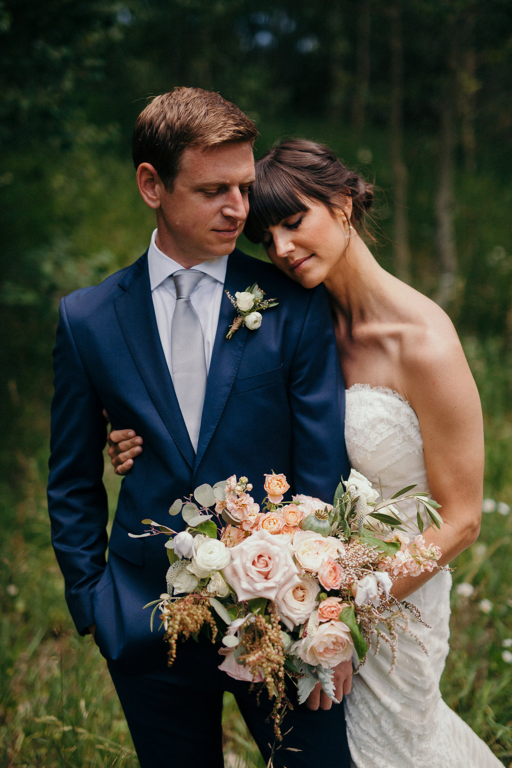 Flowers by Lace and Lilies, aspen mountain wedding, textured white and blush flowers - bridal bouquet and boutonniere. Grooms blue suit