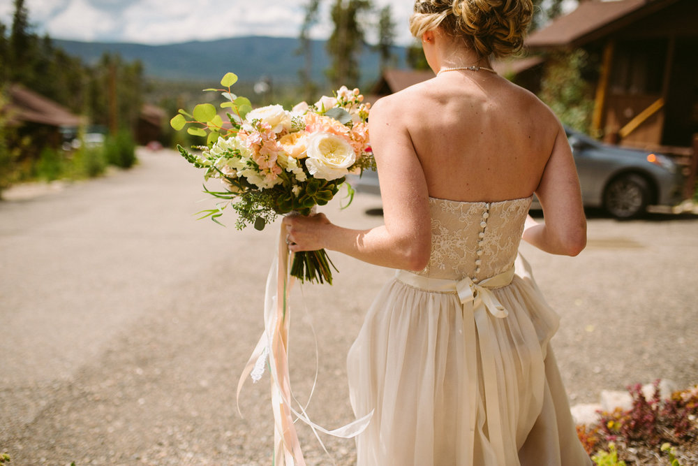 Flowers by Lace and Lilies / Colorado wedding florist - peach, sage, green, white, ivory, blush - natural, organic, romantic, whimsical - Fort Collins, Grand Lake, Destination, Travel - hanging ribbon, bridal bouquet, bride, first look, garden rose, eucalyptus,