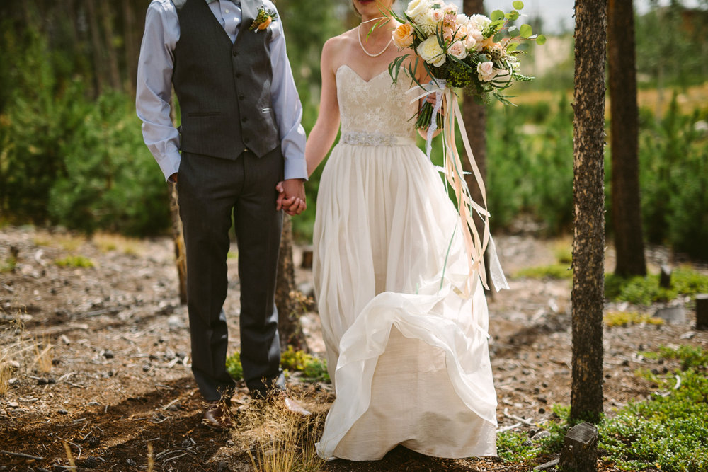 Flowers by Lace and Lilies / Colorado wedding florist - peach, sage, green, white, ivory, blush - natural, organic, romantic, whimsical - Fort Collins, Grand Lake, Destination, Travel - first look, bride and groom, hanging ribbon, ranunculus, garden rose, eucalyptus