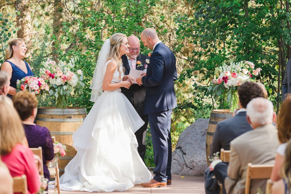 Flowers by Lace and Lilies, wedding ceremony Vail Colorado, colorful summer flowers on wine barrels