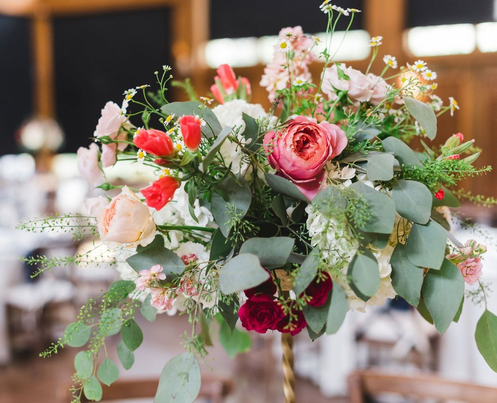 Flowers by Lace and Lilies, tall gold centerpieces, coral, peach, pink and green mountain wedding Vail Colorado