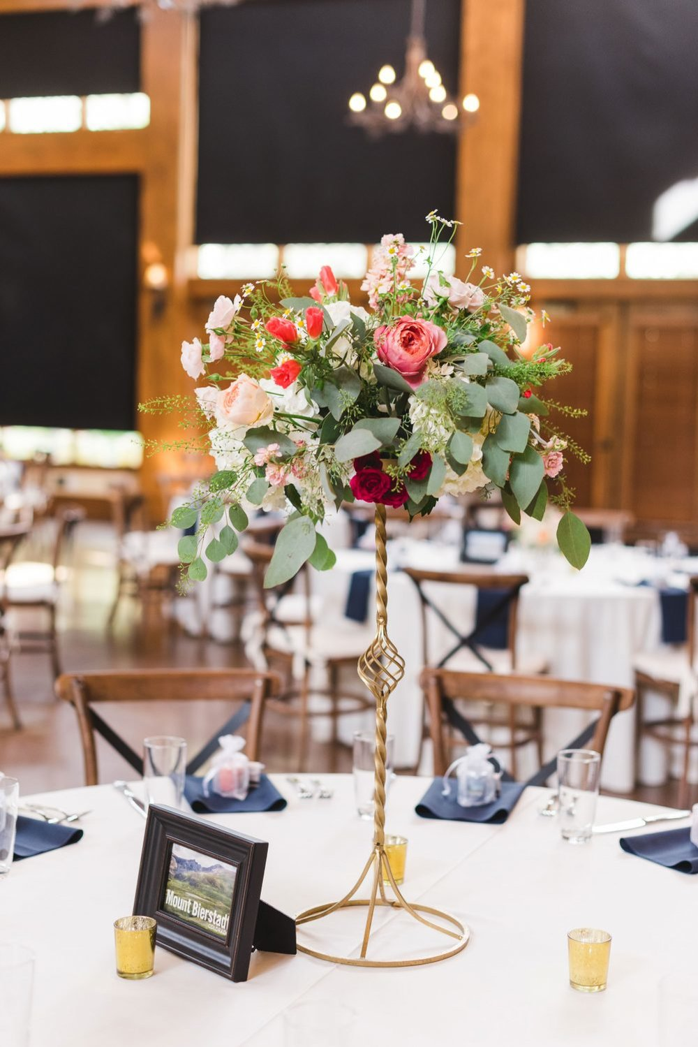 Flowers by Lace and Lilies, tall gold centerpiece, colorful and bold colors - vail mountain wedding reception