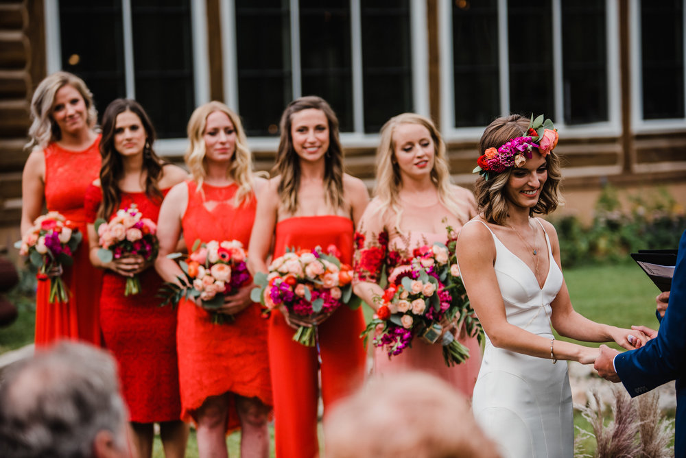 Flowers by Lace and Lilies, red bridesmaid dresses with coral, red, orange and peach bouquets