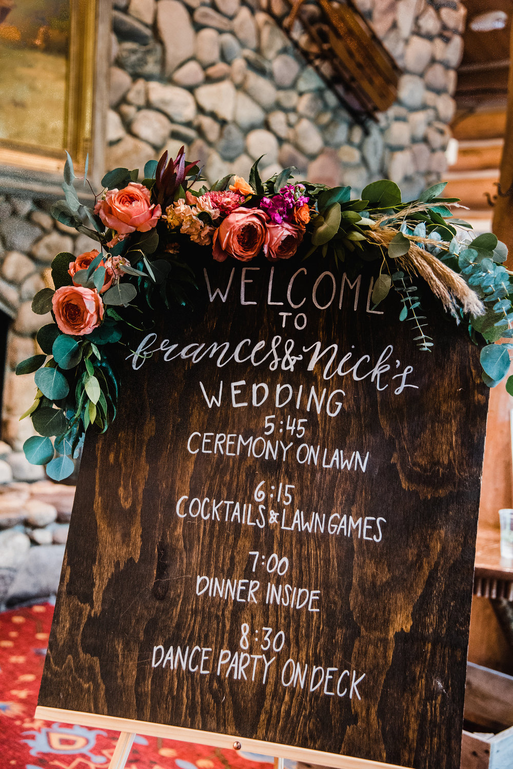 Flowers by Lace and Lilies, wedding welcome sign with colorful flowers and foliage, mountain lodge wedding