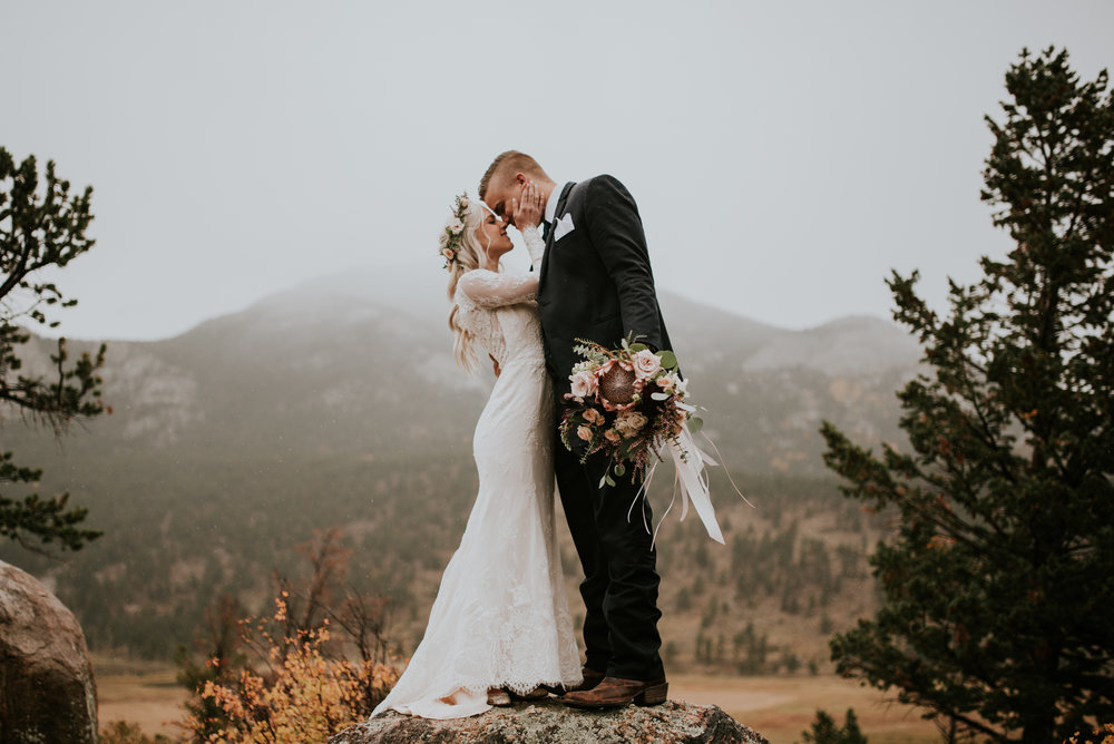 Flowers by Lace and Lilies, Estes Park Wedding, Colorado Wedding, Twin Owls Steakhouse, Black Canyon Inn, bridal bouquet, hair flower crown, blush flowers, king protea, long sleeved dress, burgundy flowers, colorado wedding, greenery chandelier, garlands, floral chandelier, reception flowers