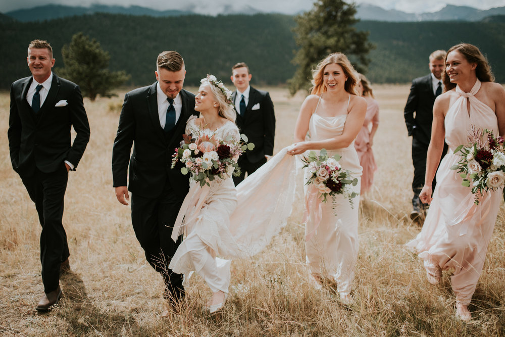 Flowers by Lace and Lilies, Estes Park Wedding, Colorado Wedding, Twin Owls Steakhouse, Black Canyon Inn, bridal bouquet, hair flower crown, blush flowers, king protea, long sleeved dress, burgundy flowers, colorado wedding, greenery chandelier, garlands, floral chandelier, reception flowers, garland