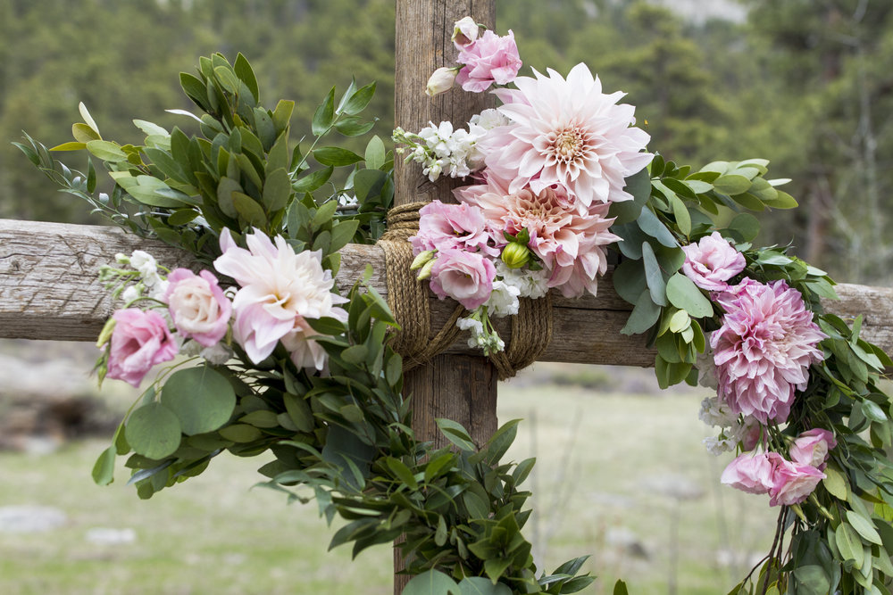 Flowers by Lace and Lilies, ceremony flowers, denver wedding, arch flowers, colorful bloom, pink wedding flowers, cross flowers, garland, estes park wedding, della terra venue, ceremony decor