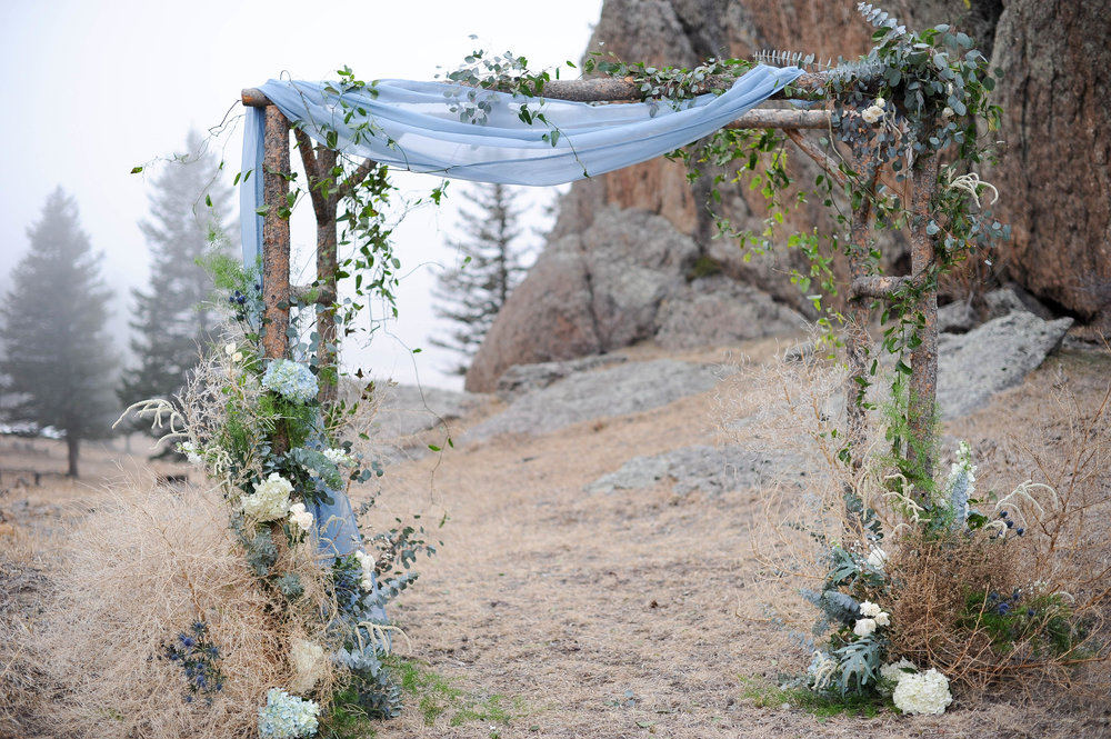 Flowers by lace and Lilies, arch flowers, ceremony flowers, foliage, greenery, wedding flowers, colorado wedding, mountain wedding