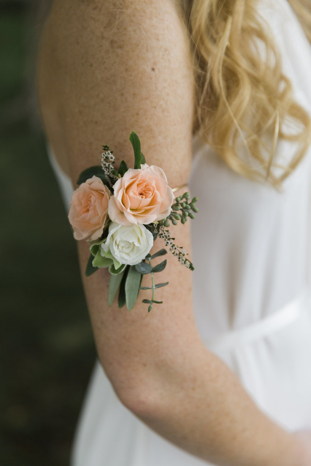 Flowers by Lace and Lilies, arm band flowers, arm flowers, wearable flowers, peach flowers, greenery, peach and white wedding, martha stewart wedding, colorado wedding, denver wedding