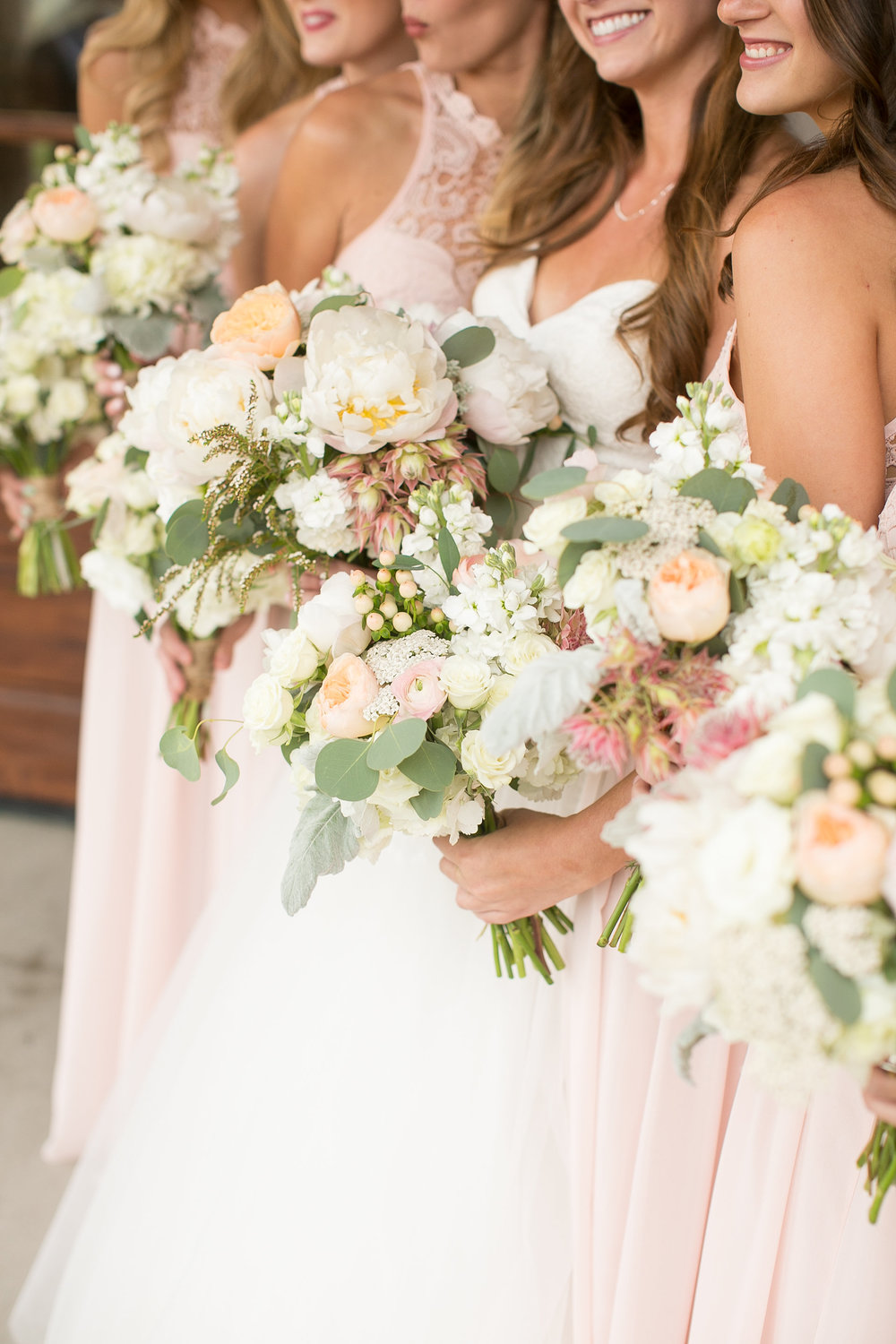 Flowers by Lace and Lilies, colorful bouquets, bridesmaid dresses, bridal bouquet, bridesmaid bouquets, colorado wedding, mountain wedding, coral wedding flowers, peach and yellow, blush and white