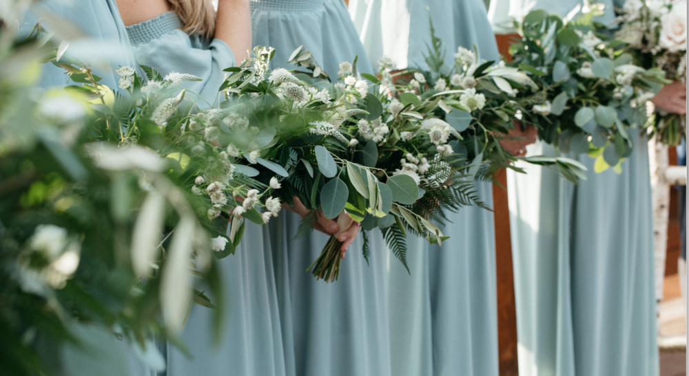 Flowers by Lace and Lilies, bridesmaids, sage green bridesmaid dresses, white and green flowers, greenery, wedding flowers, blush flowers, bridal bouquet, colorado wedding, blush and white wedding, eucalyptus, greenery, foliage, boutonniere, greenery boutonniere, texture, boutonniere, how to pin a boutonniere, greenery boutonniere, navy suit, gondola wedding, blush wedding, welcome sign, greenery cluster, flower girl, flower girl crown, flower girl petals, silver dollar petals, arrangement, greenery bouquets, sage green bridesmaid dresses, bridal party, bridesmaids, wedding gown, wedding cape, lace dress, lace gown, bridal bouquet, something blue, white and green wedding, blush wedding, birch arch, wedding decor, floral decor, greenery arch, asymmetrical design, greenery bouquet, bridesmaid bouquets