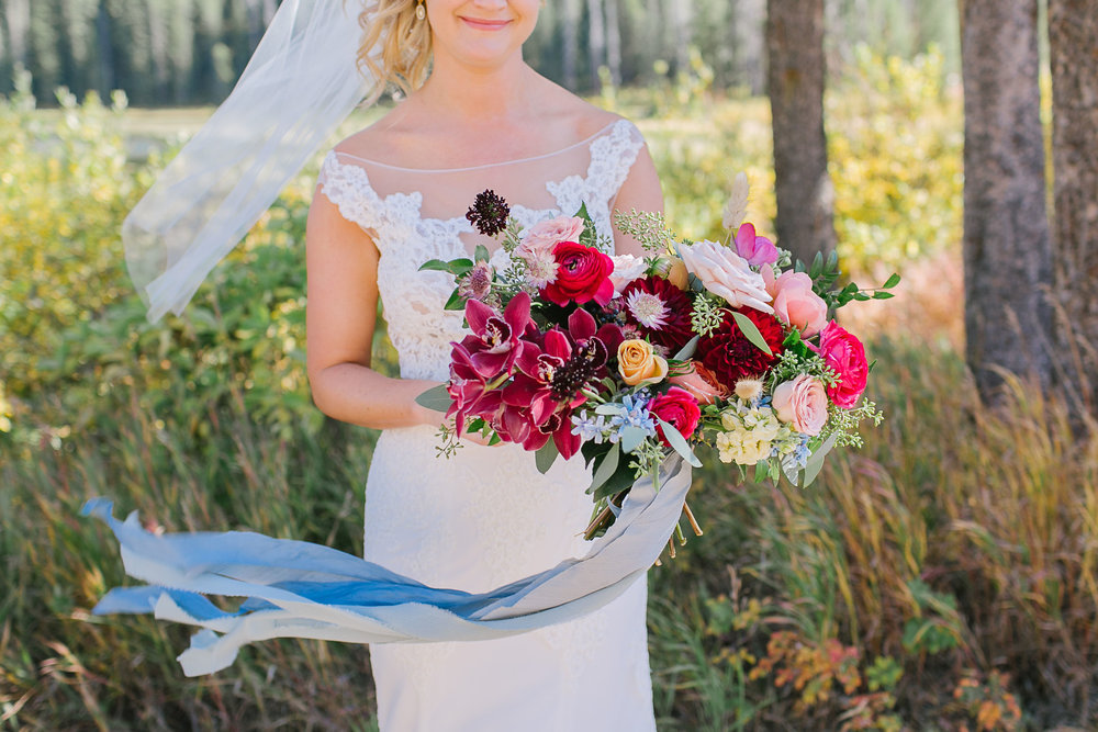 Flowers by Lace + Lilies, bridal bouquet, color palette, mountain wedding, vail wedding, burgundy flowers, yellow flowers, fall palette, fall wedding, raspberry flowers, draping ribbon, trailing ribbon, flowers, wedding flowers, bridal bouquet, mountain wedding
