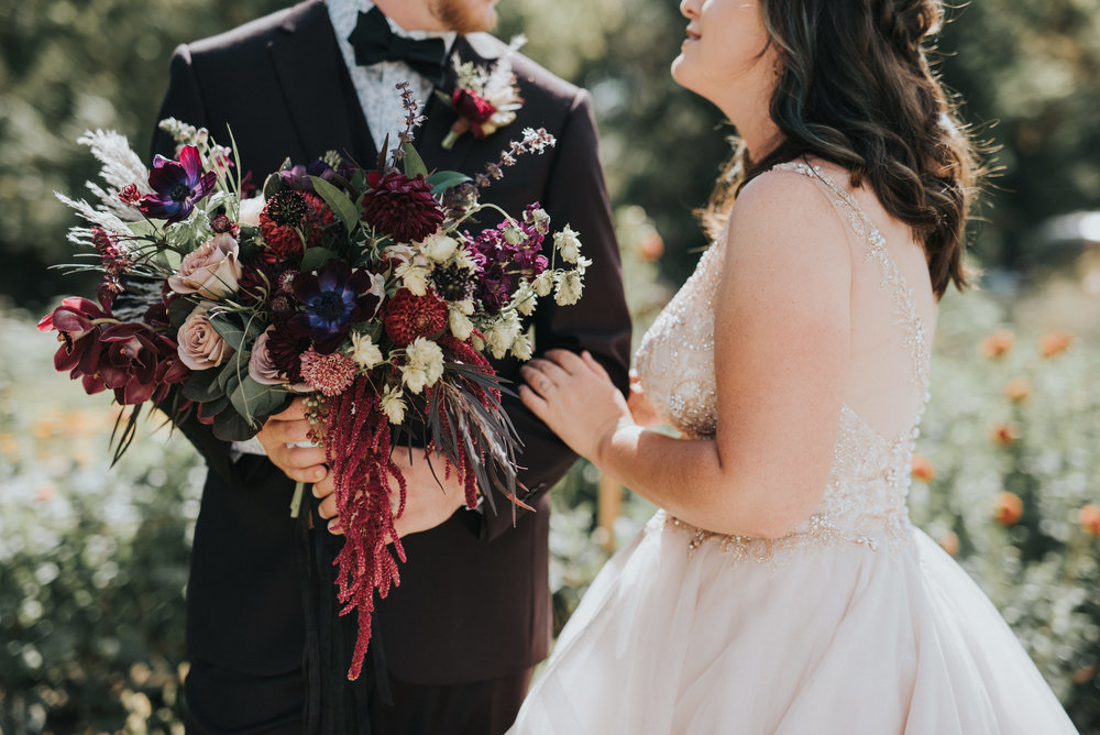 Flowers by Lace and Lilies, bridal bouquet, moody flowers, burgundy wedding, dusty colored wedding, pampas grass, lyons farmette wedding, colorado wedding, anemone, amnesia roses, bride and groom, first look, wedding photography