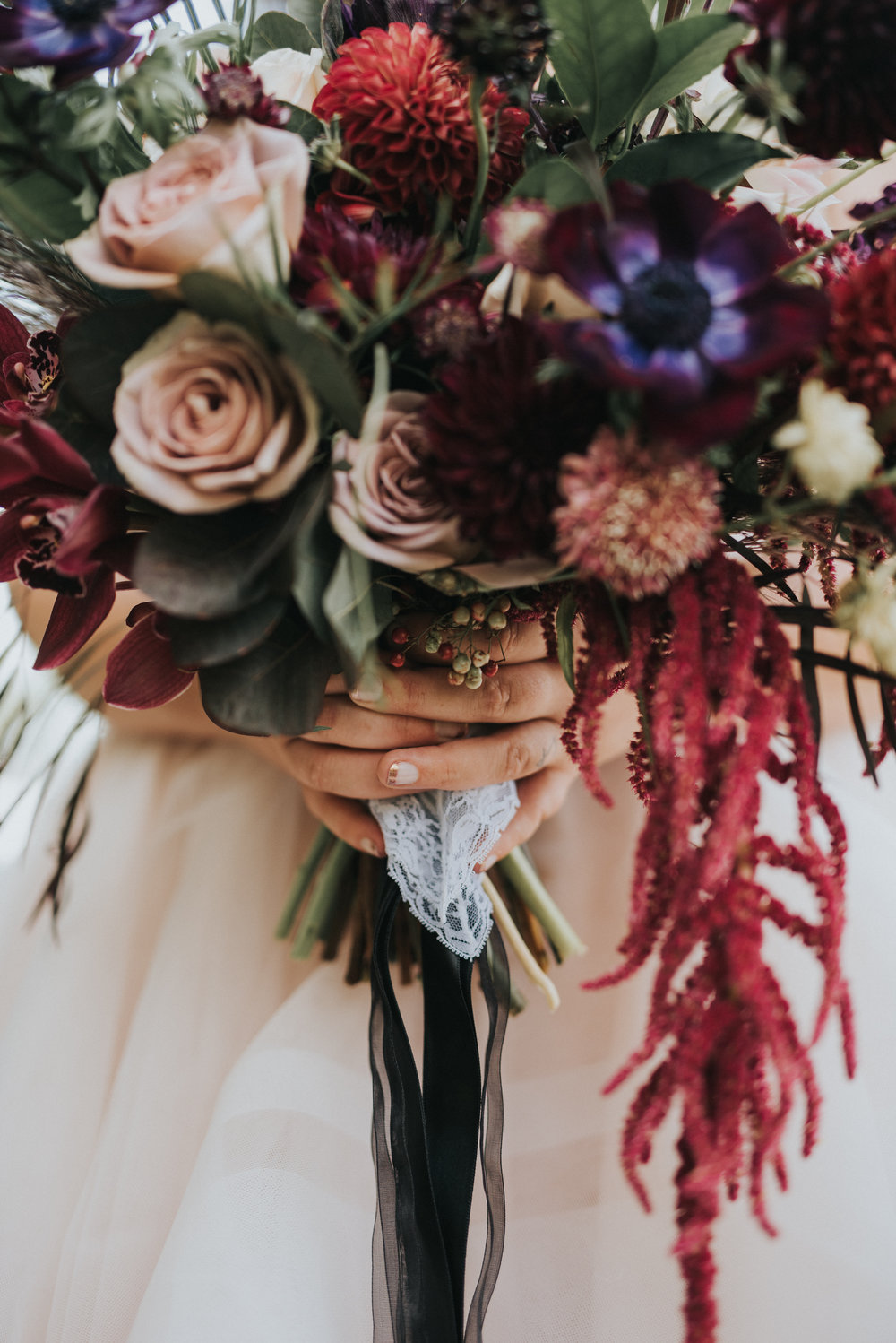 Flowers by Lace and Lilies, boutonniere, wedding flowers, jewel tones, pampas grass, hops, texture, colorado wedding, a-frame arch, arch flowers, altar flowers, ceremony flowers, moody toned wedding, pampas grass, bridal party, burgundy dresses, foliage bouquets, bouquet wrap, something blue