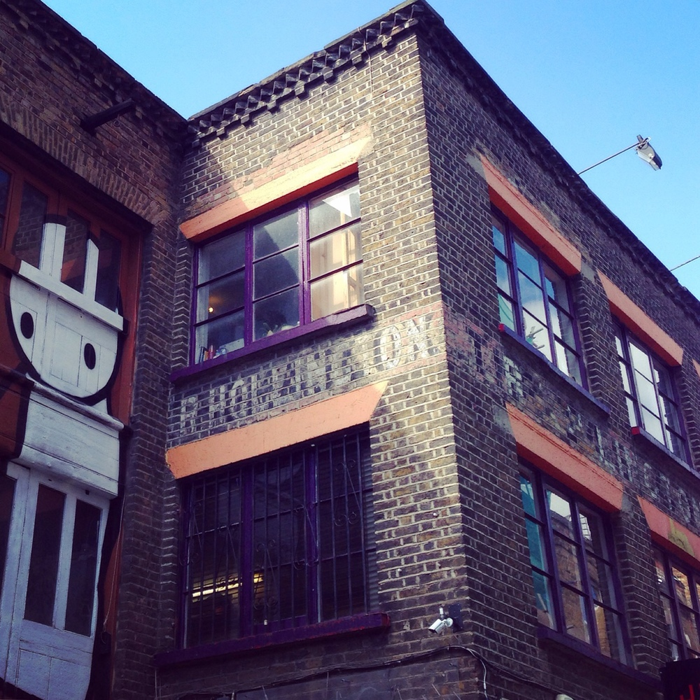 GHOST SIGN OF FURNITURE MANUFACTURER, r HOLLINGTON, STILL VISIBLE ABOVE THE COMEDY CLUB: http://urbantypo.tumblr.com/