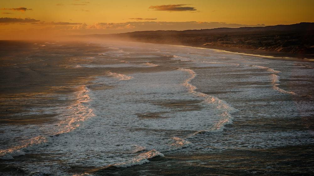 Looking down Muriwai Beach as the sun was setting