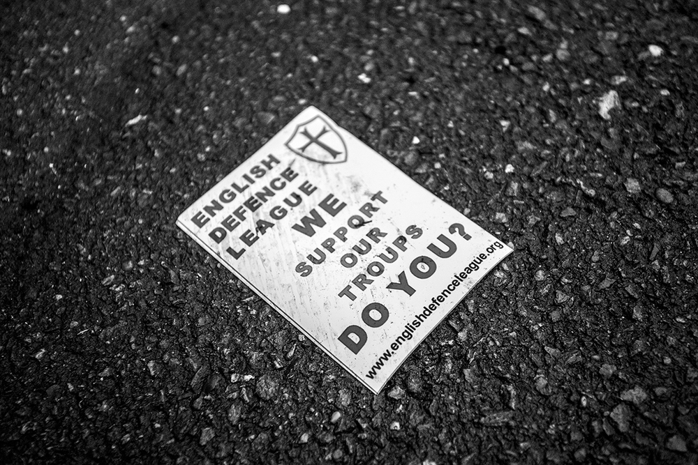 An EDL pamphlet is discarded in the road during a violent protest in Nottingham city centre.