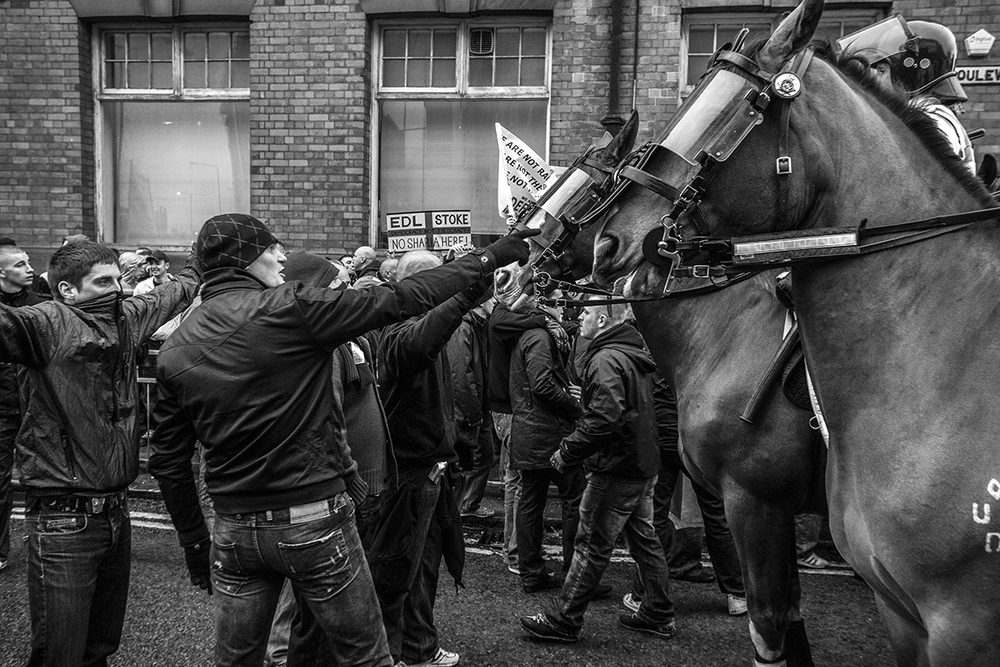 EDL members face-off with mounted riot police in Nottingham
