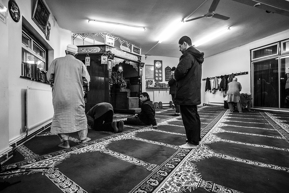 Muslims gather for prayer inside Harrow's old mosque during anti-Islam protests by the EDL, Casuals United and SIOE.